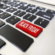 "Man pushing ""Black friday"" button on computer keyboard."