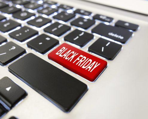 "Man pushing ""Black friday"" button on computer keyboard."