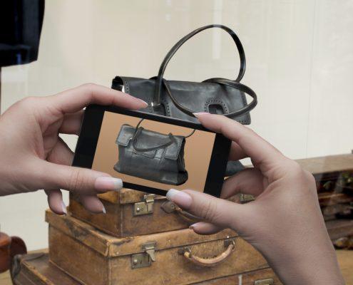 Smart phone Window shopping or showrooming  a handbag
