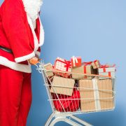 Saint Nicholas Pushing Shopping Cart Full Of Gift Boxes