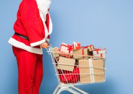 Saint Nicholas Pushing Shopping Cart Full Of Gift Boxes