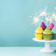 Cupcakes on a cake stand with sparklers