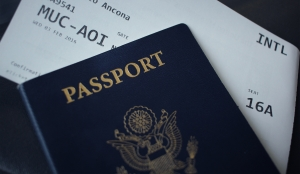 Blue passport and boarding pass